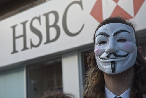Activist Wearing a Guy Fawkes Mask Outside HSBC Bank