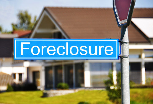Blue Foreclosure Road Sign