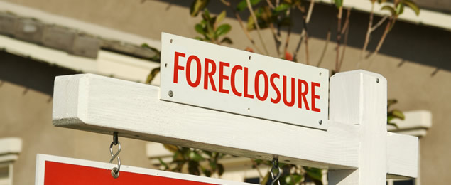 A Foreclosure Home Sign