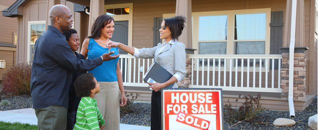 Homeowners Receiving a Key from an Agent