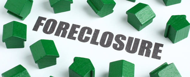 Small Green Houses Around a Foreclosure Sign