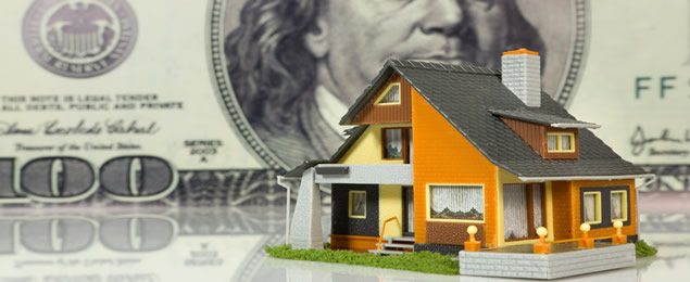 Small Plastic House in a Money Background