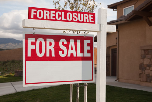 Foreclosure for Sale Sign in front of a Property
