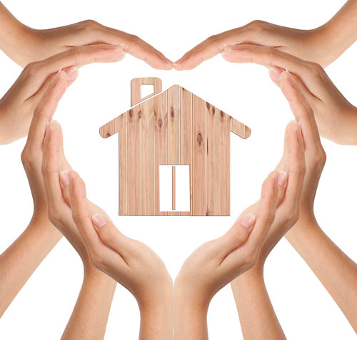 Hands Make Heart Love Shape with Wood House