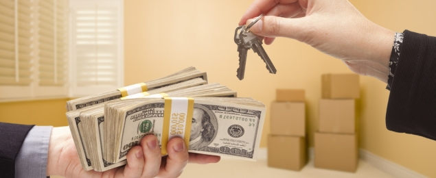 Hands with Money and House Keys Inside a Room