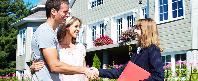 Homeowners Shaking Their Realtor Hands