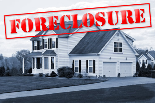 House and Red Foreclosure Stamp
