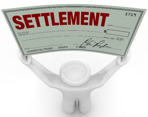 Man Holding a Large Settlement Check