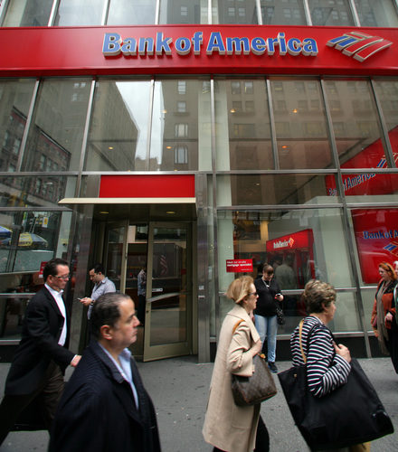 Pedestrians Walk Past a Bank of America Branch Office