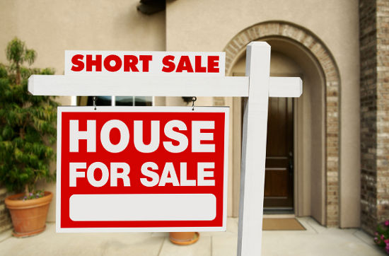 Red Short Sale Real Estate Sign and House