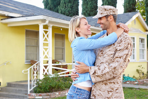 Wife and Military Husband in front of their House